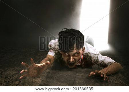 Scary Asian Zombie Man With Blood Crawling
