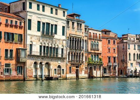 The Grand Canal on a summer day in Venice, Italy. Grand Canal is one of the major water-traffic corridors in Venice.