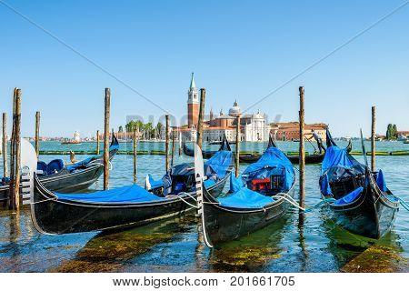 Pier with gondolas near Saint Mark`s Square in Venice, Italy. The gondola is a traditional romantic transport in Venice.