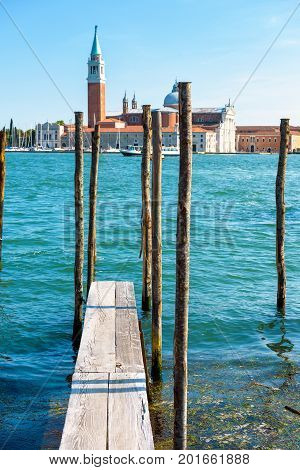 Wooden berth for gondolas and boats in Venice, Italy