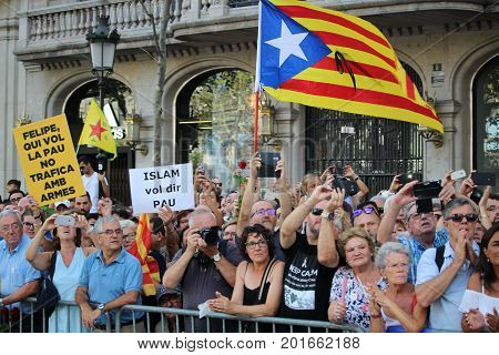 BARCELONA/SPAIN - 26 AUGUST 2017:  Massive participation at the protest against terrorism in Barcelona, with over 500.000 people holding messages of love, against terrorism and against the monarchy