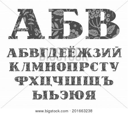Russian alphabet, berries and grass, gray, vector. Capital letters of the Russian alphabet with serif. The gray berries, twigs and flowers on a dark gray background.