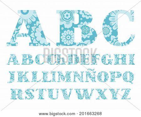 The Spanish alphabet, colors, decorative, blue, vector. Uppercase letters of the Spanish alphabet with serif. Light blue, decorative flowers on a blue background.
