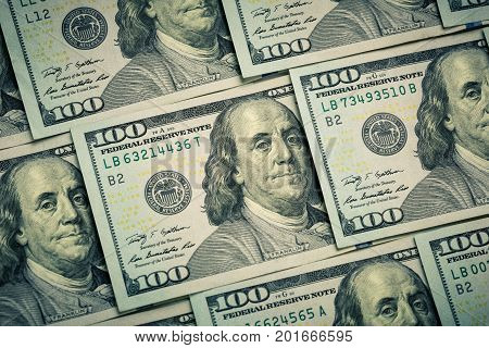 Lot of one hundred dollar bills close-up background. Bank. Business. Casino. Wages. Pattern