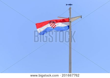 SPLIT, CROATIA - 12 JULY, 2017: Flag of the city of Split, Croatia. Against the background of a cloudless sky.