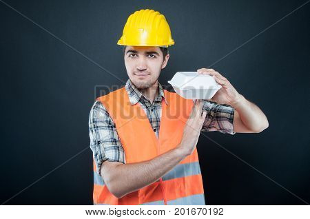Constructor Making Time Out Gesture With Lunch Break