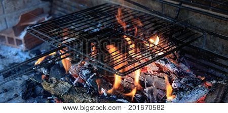 Hot empty BBQ grill with bright flames