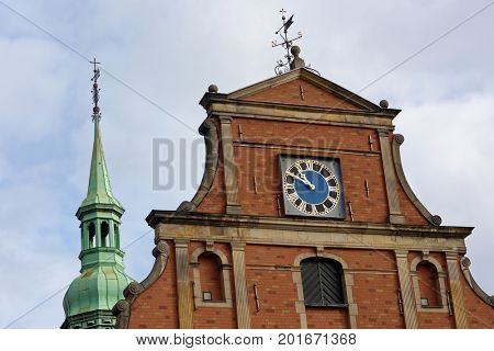 COPENHAGEN, DENMARK - NOVEMBER 7, 2016: Clock on the Church of Holmen. Built as an anchor forge in 1563 it converted to church in 1619 and hosted the wedding of  Margrethe II and Prince Henrik in 1967