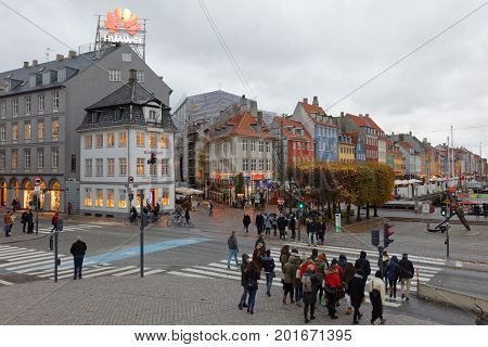 COPENHAGEN, DENMARK - NOVEMBER 6, 2016: People on Kongens Nytorv square in an autumn day. The largest square of the city, it was laid out by Christian V in 1670