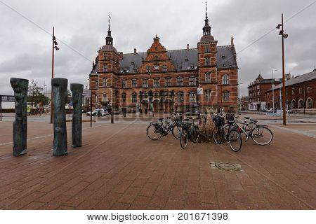 HELSINGOR, DENMARK - NOVEMBER 6, 2016: Bicycle parking in front of train station building of Helsingor. The building was erected in 1891