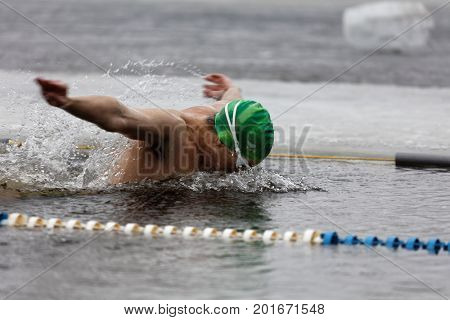 ST. PETERSBURG, RUSSIA - MARCH 18, 2017: Man participates in the winter swimming competitions in river Neva. The event aimed to revive the winter swimming tradition dated back to 1960-1990s