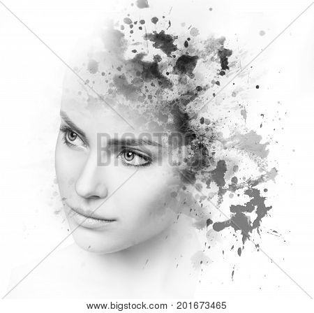 Double exposure portrait of young woman and watercolor blots isolated on white.