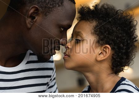 profile portrait of beautiful african american father and son looking at each other