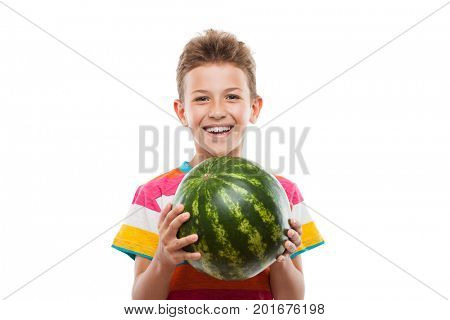 Handsome smiling child boy hand holding green ripe watermelon fruit food white isolated