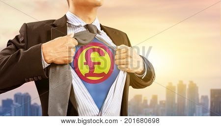 businessman in superhero costume with British pound sterling sign and city background