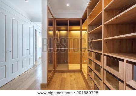 Cabinets and an empty dressing room made of wood, for the family.