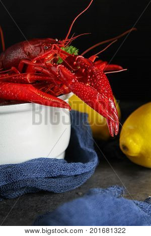 Delicious Boiled Crayfish Close-up With Lemon And Parsley. Dark