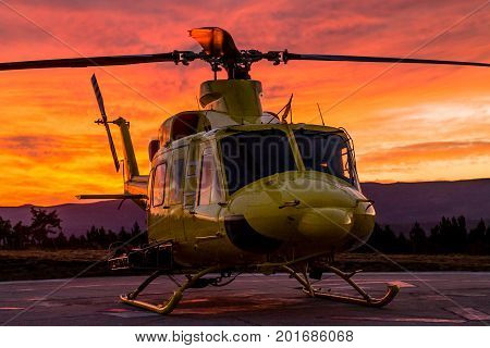 A front side wildfire helicopter view on a stunning sunset