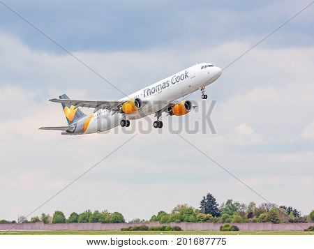 Airplane From Thomas Cook After Takeoff, Sky With Clouds