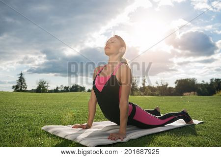 Relaxed Woman Practicing Yoga Pose