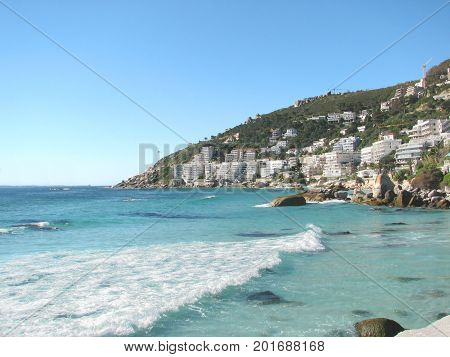 FROM CLIFTON, CAPE TOWN, SOUTH AFRICA, WITH LOVELY CLEAR WATER IN THE FORE GROUND AND LIONS HEAD MOUNTAIN IN THE BACK GROUND