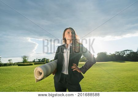 Businesswoman With Yoga Mat
