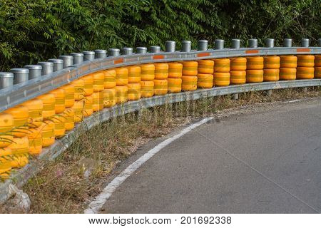 guardrail is a system designed to keep people or vehicles from straying into dangerous or off-limits areas.