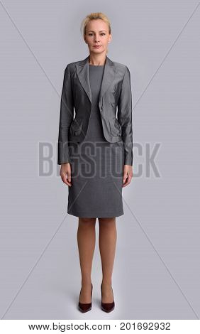 Full Length Portrait Of A Mid Aged Business Woman