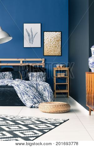 Sophisticated Bedroom With Blue Walls