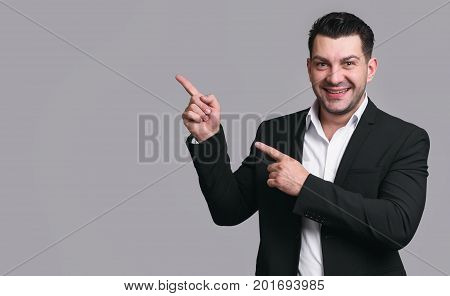 Handsome Happy Businessman Pointing Finger