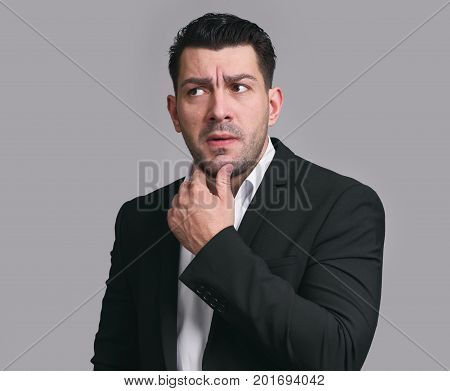 Confused Businessman Thinking About Problem