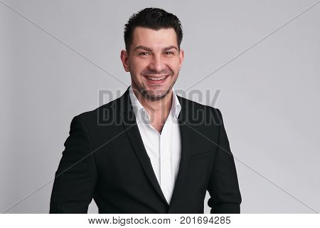 Cheerful Handsome Smiling Man In Black Suit