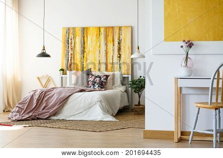Energetic Bedroom With Yellow Artwork