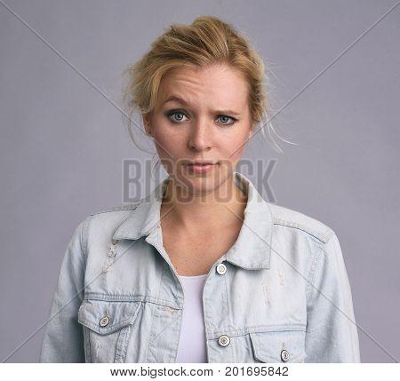 Serious Beautiful Woman Raising An Eyebrow
