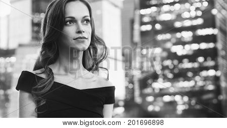 Beautiful Woman In The Street Of Big City