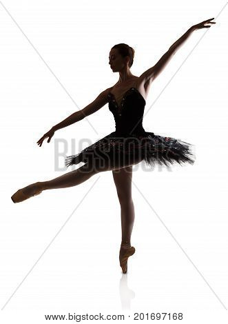 A ballerina silhouette making pirouette against white background, isolated. Professional dancer in tutu skirt. Choreography classes concept