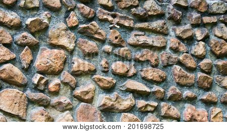 A rock wall makes an interesting background pattern. architecture structure
