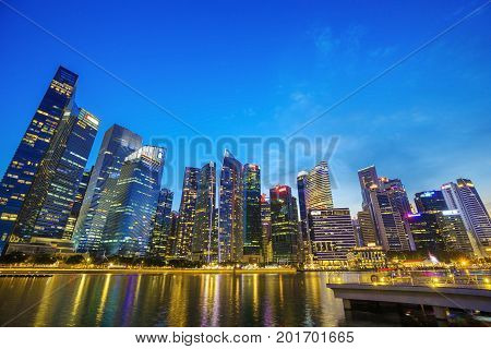 Central Business District Building Of Singapore City At Twilight Time