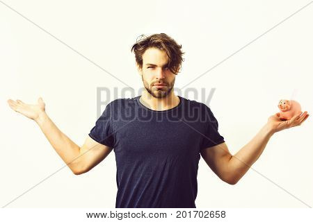 Bearded man short beard. Caucasian sexy young macho with stylish hair and moustache on serious face holding pink piggy pig bank in blue shirt with raised hands isolated on white studio background