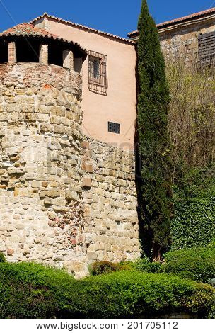 Obsolete House with Tower Gallery and Surrounded Wall with Plants Outdoors. Salamanca Spain