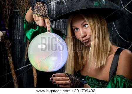 Beautiful Young Witch Posing With Magic Ball