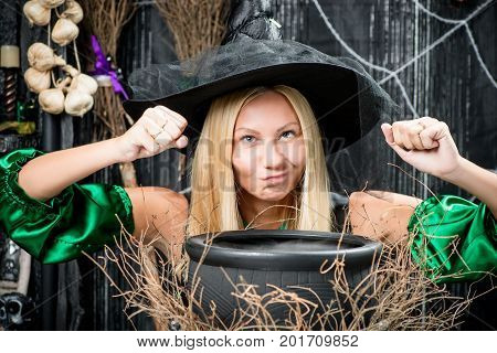 Witch Blonde Cooks Potion And Pronounces Spell