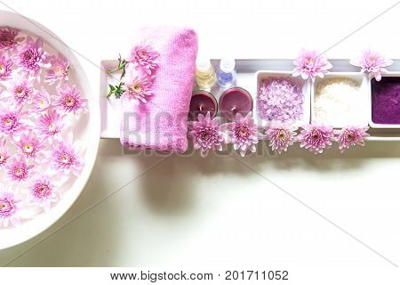 Thai Spa Treatments aroma therapy salt and sugar scrub and rock massage with pink flower on wooden white. Healthy Concept. copy spaceselect and soft focus