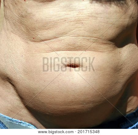 The big belly of a man. obesity