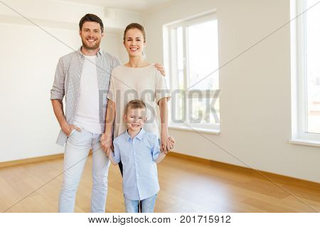 mortgage, people, housing and real estate concept - happy family with child moving to new home