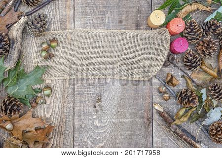 Burlap Banner, Blank Sign, On Rustic Wooden Background With Acorns, Pinecones, Leaves And Branches