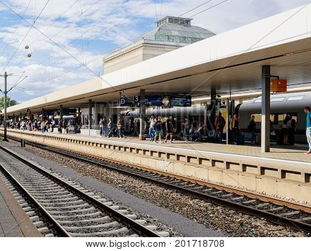 MANNHEIM GERMANY - AUG 8 2017: Large group of people waiting for fast ICe train at the train station platform in Mannheim hauptbahnhof Train station commuting in German
