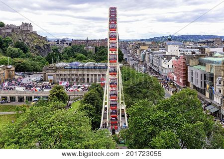Edinburgh, United Kingdom - August 15, 2014: View of  the Festival Wheel, a large and temporary mechanical Ferris Wheel, situated in the centre of Edinburgh, in East Princes Street Garden