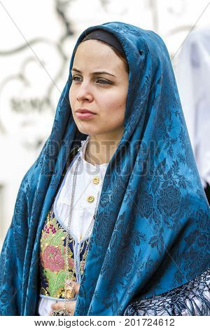 CAGLIARI, ITALY - MAY 1, 2014: 358 Religious procession of Sant'Efisio - portrait of a beautiful woman in traditional Sardinian costume - Sardinia