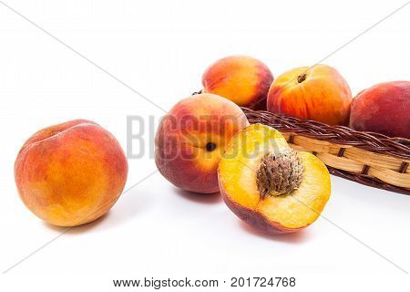 Whole And Half Of Ripe Peach Fruit And Several In Basket Isolated On White Background.